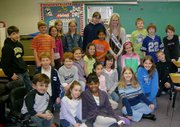 Ashley Aull, Miss Kansas USA 2006, is surrounded by a class at Leawood Elementary School. Aull read to the students in December.