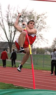 Lansing High junior Kyle Buehler lifts off as he attempts to clear 9 feet, 6 inches in the pole vault Friday at the Bobcat Relays. Buehler placed second in the event.