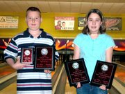 Tyler Wiehe, left, and Heather Wiehe display the plaques they received for winning state championships at the Kansas Youth State Bowling Tournament in December.
