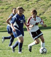 LHS junior Courtney Hall dribbles past a Gardner-Edgerton player to begin a new offensive push during the junior varsity Lions' 1-0 victory Tuesday.