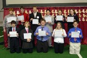 Students of Lansing High School's Future Business Leaders of America team display their certificates for placing in the top 10 in their events at the state competition at the Topeka Expocentre on March 31. Back row, from left, are Sean Wooley, Stephen Fischer, Matt Humphreys, Will Dolan, Kristin Brandt and Jessica Garrett. Front row, from left, are Matt Fischer, Edwin Fleuvog, Guy Gardner, Brooke McGovern and Brent Huffman.