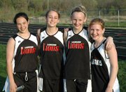 Lansing Middle School eighth-graders Briana Hall, Lauren Jaqua, Madison Brandt and Sarah Nielsen are all smiles after shattering the school record in the 1,600-meter relay.