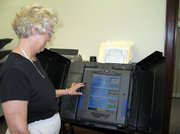 Leavenworth County Clerk Linda Scheer demonstrates how to use one of the county's new iVotronic voting machines. The machines were used in Tuesday's primary election -- a first in Leavenworth County. Election officials reported only minor problems with the machines Tuesday.
