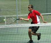 Lansing High senior Cory Collins drops a shot over the net at No. 1 singles. Collins placed fifth Thursday at the Leavenworth Invitational.