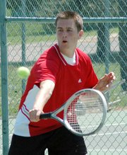 Lansing High junior Josh Robinson returns a shot during his No. 1 doubles championship match Thursday at the Leavenworth Invitational.