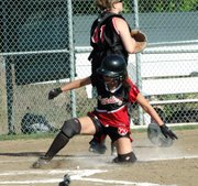 Morgan Chiles slides safely into home against Bishop Ward.
