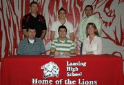 Lansing High senior Sean Flynn, pictured center front, signed his letter of intent April 18 to wrestle at South Dakota State University. With him at the signing ceremony are, front row, his parents, Mike and Paula Flynn, and, back row, from left, LHS wrestling coach Ron Averill, brother Nick Flynn and LHS assistant wrestling coach Brian Rees.