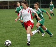 Lansing High sophomore forward Rachel Pride breaks away from the Immaculata on her way toward the goal.