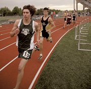 Adam Justice leads a group in Friday's 1,600-meter race. Justice finished fourth in the event.