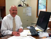 Brian Bode, president of the Lansing School Board, is the new dean of finances at Kansas City Kansas Communiy College.