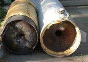 Walt Carrigan, operator of Walt's Plumbing, recently removed these two water heaters from a Lansing home. Carrigan said the heater on the right, with the kinked flue and bulbous bottom, is an example of what can happen when a heater isn't outfitted with a thermal expansion device but the water meter has a dual check valve installed. A kinked flue can lead to the leaking of dangerous carbon monoxide into the house, he said.