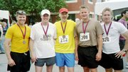 Tad Laurence, a Lansing resident, completed his first marathon May 20 when he ran in the Olathe Marathon. He ran with four students from Fort Leavenworth's Command and General Staff College. Pictured are, from left, Brian Freidhoff, Kevin Kelly, Laurence, Rob Bowers and Frank Turner.