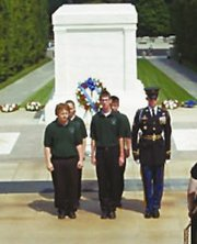 Josh Adkins, Nathan Cardiff, Carrie Buser and Kasey Willnauer take part in a Memorial Day ceremony at the Tomb of the Unknown Soldier as part of the De Soto High School band's trip to Washington, D.C.