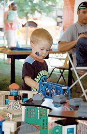 Cole Minton, 2-and-a-half-years old, was playing with the Thomas toys Friday. His mother, Angela Minton, brought him from Derby for the annual event.