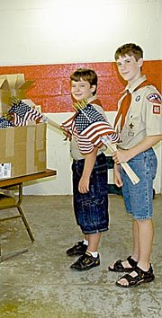 Members of the Baldwin Boy Scout Troop 65 will be delivering this year's Fourth of July flags in yards all around town. Two of them will be James Jarvis and Austin Kraus.