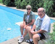Sue and George Kersten retired at the end of the school year with a combined 74 years of teaching in the Lansing school district. They're shown by the swimming pool at their home, where they intend to spend some time relaxing.