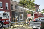 Leavenworth and area fire crews work to extinguish a fire in the 700 block of Shawnee Street in downtown Leavenworth on July 6.