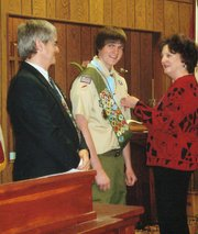 Jonathan Jeb Stewart, center, was awarded the Eagle Scout rank earlier this year. Pictured with him are his parents, Dr. Jack C. and Sarah Stewart