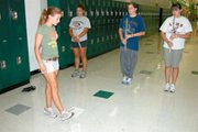 Senior Morgan Frehe shows fellow flute players Janessa Lane, Katherine Petty and Liz Valenzuela, all freshmen, how to take a correctly-sized step.