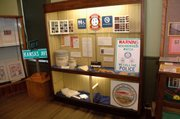 "A display case at Lansing Community Museum shows off some of the products made by Lansing Correctional Facility inmates involved with Kansas Correctional Industries. An exhibit, ""LCF: Providing Service to Our Neighboring Community,"" opened this week at the museum."