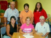 Kasey Denney, a 2006 Lansing High graduate, signed a letter-of-intent Aug. 8 to play softball at Dodge City Community College. Pictured at the signing ceremony are, from left, front row: Julie Denney, Kasey Denney, Terry Denney. Back row: LHS coach Terry Cornett, Travis Denney and LHS assistant coach Amy Turner.