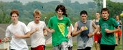 Lansing High cross country runners, from left, Michael Hornick, Matt McCurry, Griffin Davis, Jim Mayes and Brandon Craig pace each other during a Thursday workout. The LHS boys hope they will find strength in numbers by running as a pack during races this fall.