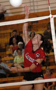 Lansing High senior Riann Deere pounds a kill during the Lions' Red-White Scrimmage on Thursday at LHS.