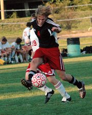 Andy Dick, Lansing High senior, unleashes a shot on goal Tuesday during Lansing's 3-0 victory at Tonganoxie. LHS outshot THS 42-8 in the game.