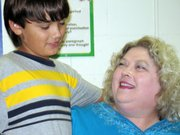 "Derek Mein, a fourth-grader at Lansing Intermediate School, introduces his ""Mamah"" Linda Scrivo, of Overland Park, during Grandparents' Hour on Friday. Brandi Lynn's students invited their grandparents to share time with them in the classroom in conjunction with National Grandparent's Day, which was held Sunday."