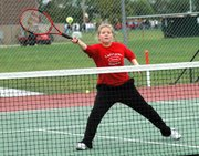 Lansing High senior Heidi Schultz drops a shot over the net for a point during her third-place match Tuesday at the Trailblazer Invitational in Gardner.