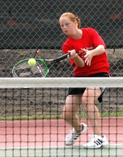 Lansing High freshman Amy Briggs rips a forehand return at Tuesday at Gardner. Briggs competed against Wednesday at the Baldwin Invitational. She went 2-2 at Baldwin.