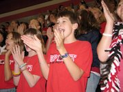 Nick germonprez, a seventh-grader and Pep Club member, cheers for the Lions during Lansing Middle School's first pep rally of the year. LMS offers students the opportunity to display their school spirit as members of the only Pep Club at public middle schools or junior high schools in Leavenworth County.