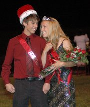 Lansing High seniors Stefan Froelich and Abby Hauver savor the moment after being crowned homecoming king and queen for 2006.