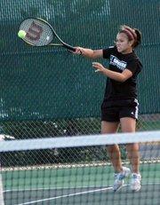 Lauren Elkins rips a forehand Saturday at the Wildcat Invitational in De Soto.