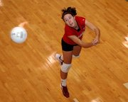 Lansing High senior libero Riann Deere lunges for a dig Saturday at the Louisburg Tournament.