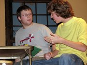 """Speed (Zach Beatty), left,  and Vinnie (Austin Keeling) rehearse a scene from """"The Odd Couple."""" Lansing High will present the play Oct. 5 and 6."""