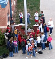 "Students, teachers and parents gather around the flagpole at Lansing Middle School with teacher Ron Averill, left center, for the annual ""See You at the Pole"" before school on Wednesday, Sept. 27. The event began in Texas in 1990 when a group of teenagers assembled around flagpoles and prayed for their friends, schools and leaders. Lansing Middle School has observed the event for several years, Averill said."