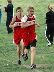 Lansing High's Matt McCurry and Brandon Craig head toward the home stretch in the varsity boys race at the Lansing Invitational.