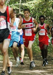 Lansing High freshman Brandon Craig makes his way through the pack Saturday at the Rim Rock Farm Invitational in Lawrence.