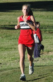 Lansing High senior Lori Flippo competes Thursday at the Kaw Valley League meet at Wyandotte County Park.