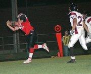 Lansing High senior tight end Joe Kohl hauls in a 28-yard touchdown reception in the first half Friday against KC-Washington.