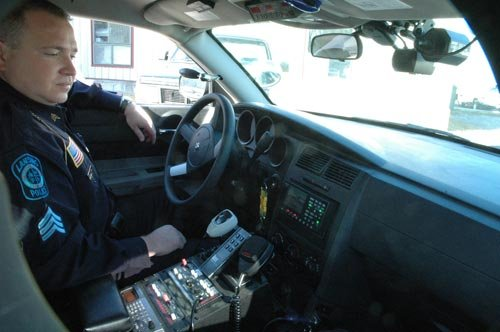 Lansing Police officer Billy Blackwell II looks at video being captured by the ICOP digital camera in his patrol car. Four of the Lansing Police Department's cars are outfitted with the new system, which Blackwell says is like having a partner in the car.