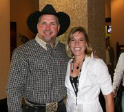 Country music star Garth Brooks and Lansing resident Sherri Schwinn share a moment at Harrah's Casino in Kansas City, Mo. Brooks was in town for the Garth Brooks Teammates for Kids Foundation charity dinner, auction and golf tournament; Schwinn was a photographer at the event.