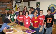 "Fourth-graders in Carol Caplinger's class at Lansing Intermediate School demonstrate they are ""good sports who don't use drugs"" by participating in Red Ribbon Week. The event began in 1988 and aims to reinforce the benefits of saying no to alcohol, drugs and tobacco. Lessons and activities throughout the week also warn students of the harm drugs can cause."