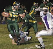 Basehor's Tyler Miles tried to gain some yardage in Thursday's game against Piper.
