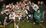 The Bobcat's boys soccer team revel with their regional win Friday night.