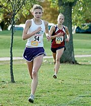 Baldwin High School junior Heather Garcia (No. 54) leads rival Brittney Graff, Eudora, by a few meters during the middle of the race Saturday. Garcia went on to win the Class 4A race in a time of 14:05, to become the third BHS girl to win the individual title.