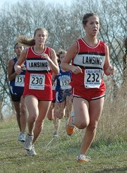 Lansing High's Lori Flippo, left, and Abbey Lozenski compete during the Class 5A state cross country meet Saturday at Rim Rock Farm in Lawrence.