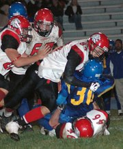 The Lansing High defense shuts down Schlagle's running game.