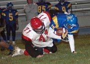 Lansing High sophomore Tyler Strouhal makes one of his team-high 10 tackles against Schlagle.